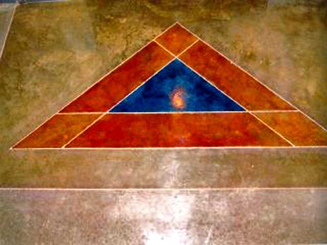 stained triangle in a concrete floor by concrete company  in eau claire wisconsin