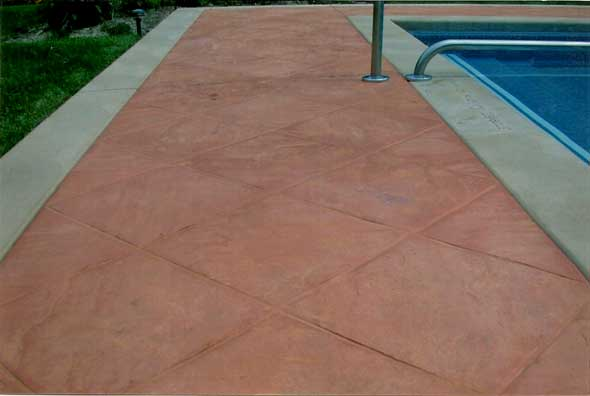 stamped concrete pool suround made by concrete connections in eau claire wi